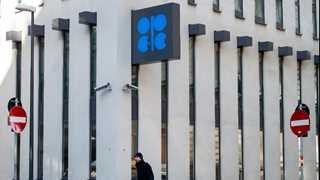 Oil lower amid supply increase hints at OPEC summit