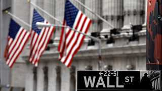 Wall Street ends mostly higher, Netflix shares lead gains