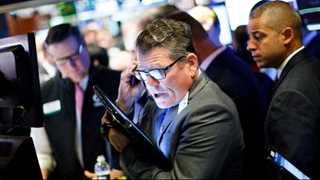 Wall Street closes higher as China retaliates against US tariffs