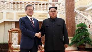 Kim, Moon pledge to denuclearize Korea