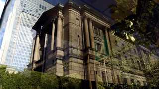 BoJ notes risks of yuan drop, US-China trade war