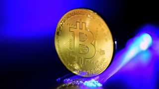 Cryptocurrencies soar, Bitcoin touches 7,000